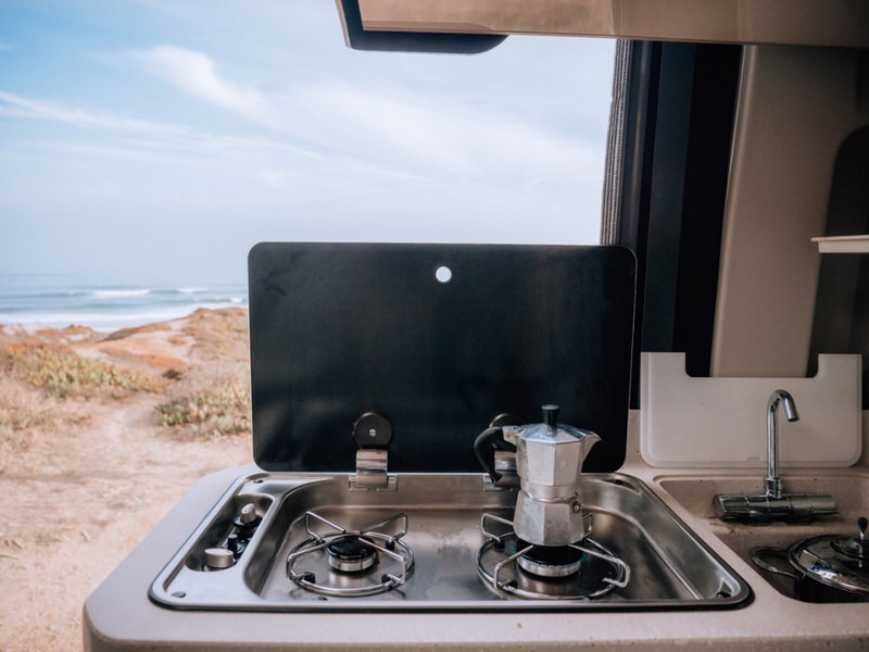 camper stove at beach making coffee