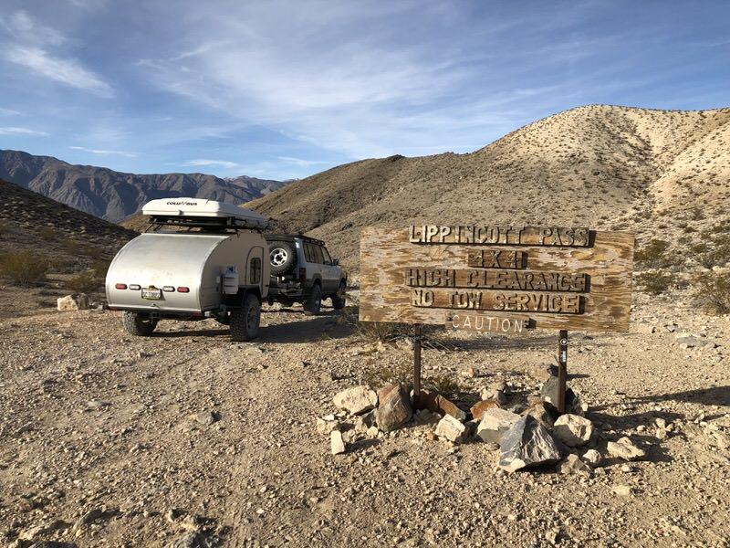 Teardrop trailer being pulled in the desert
