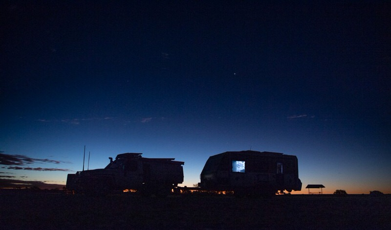 Silhouette of a truck towing a camper