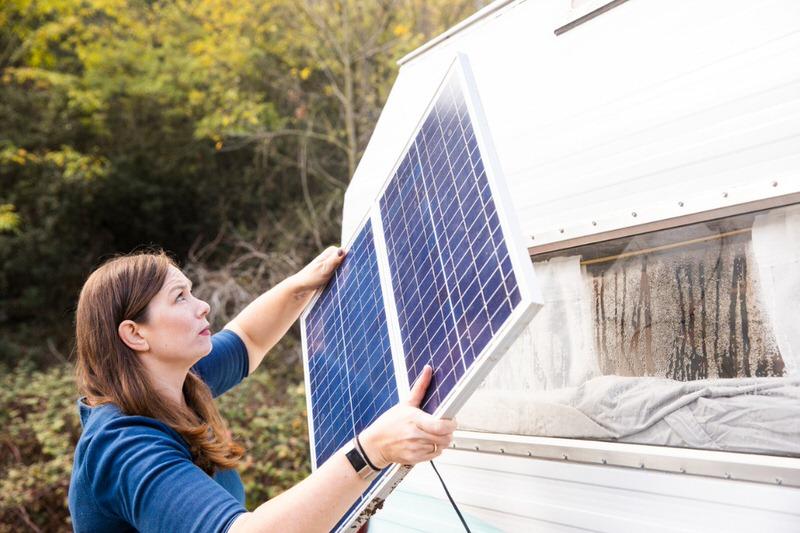 woman installing solar panel