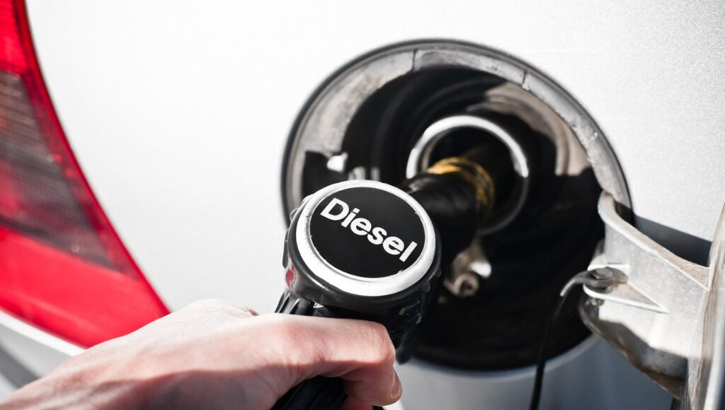 Person putting Diesel in a gas tank