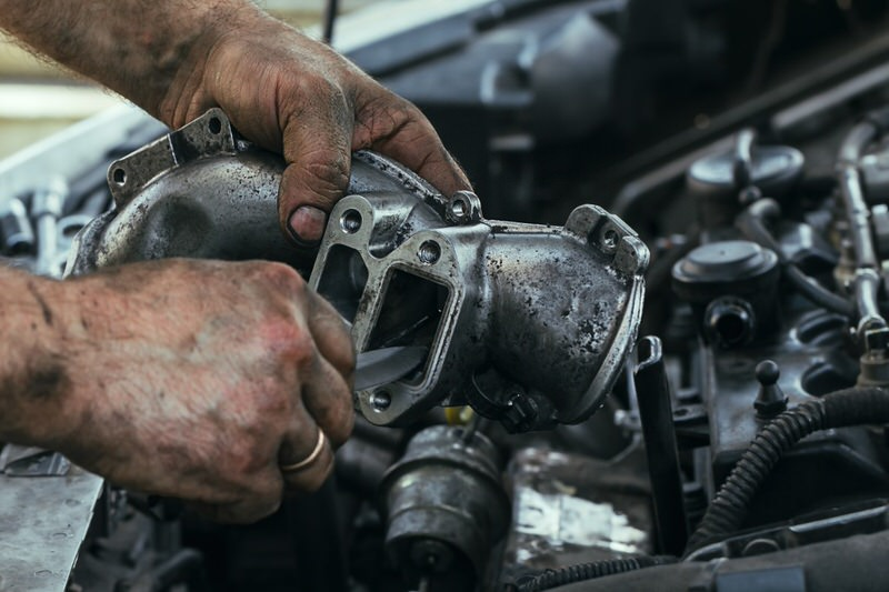 person working on engine