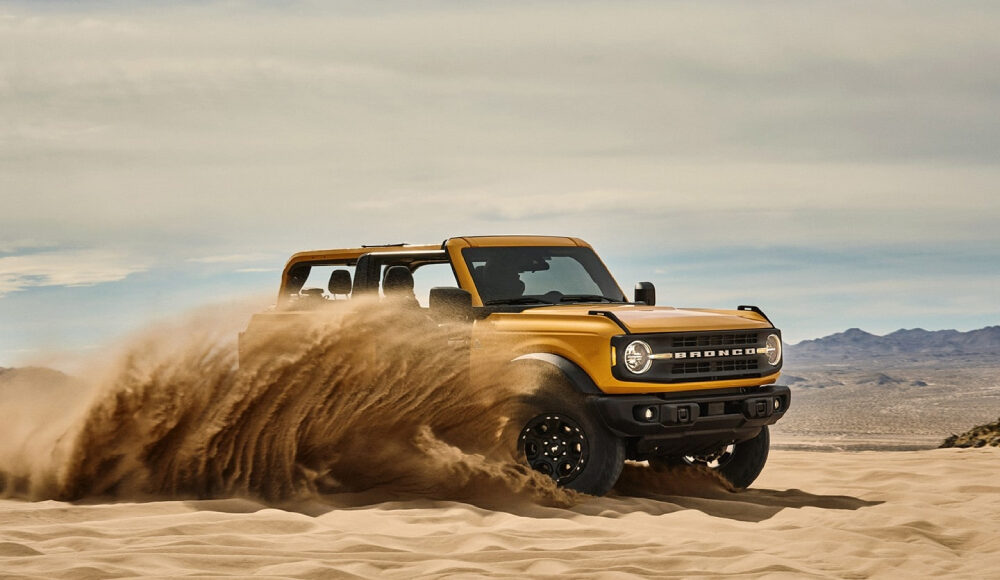 New Ford Bronco driving in sand